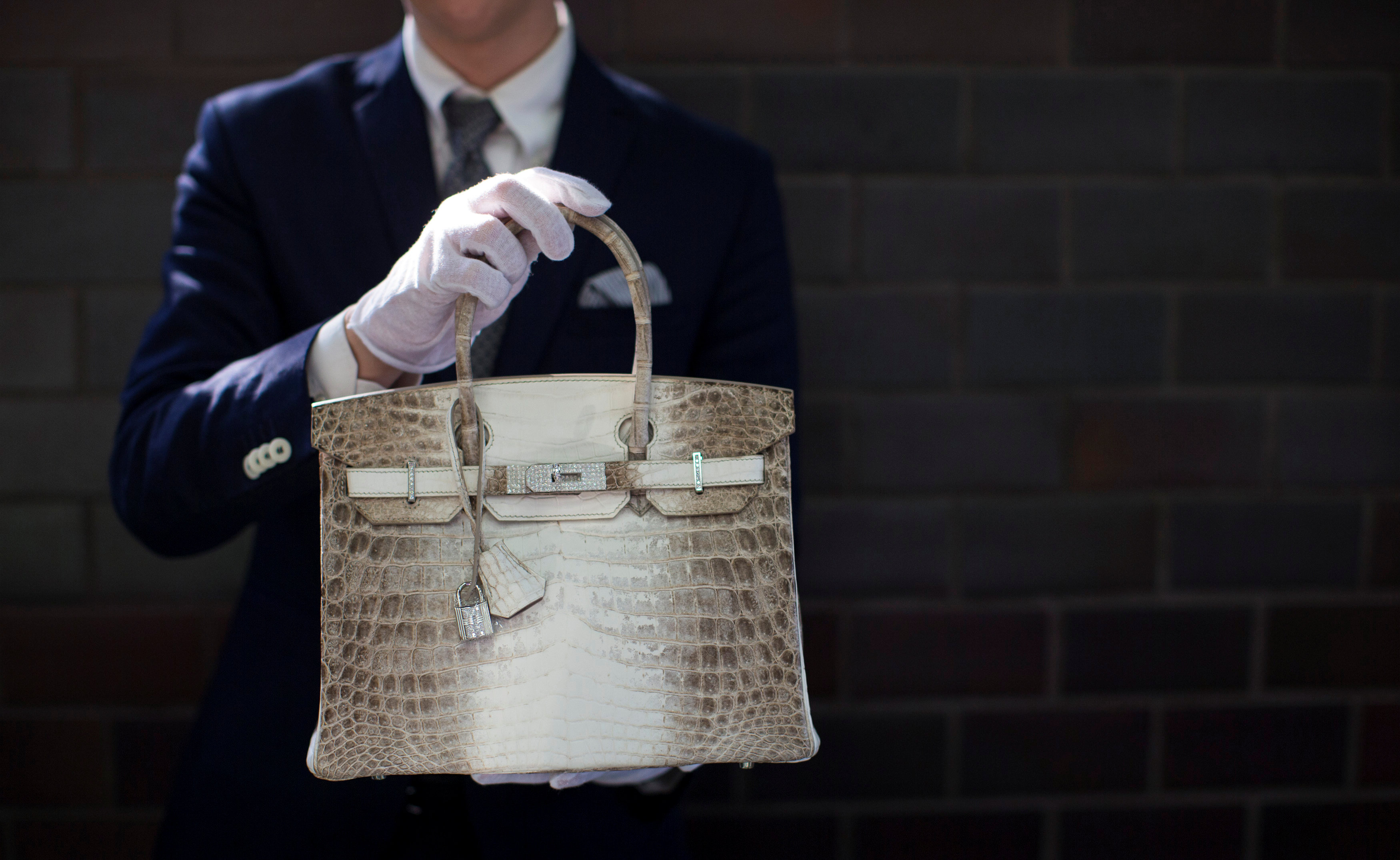 FILE PHOTO: An employee holds an Hermes diamond and Himalayan Nilo Crocodile Birkin handbag at Heritage Auctions offices in Beverly Hills, California